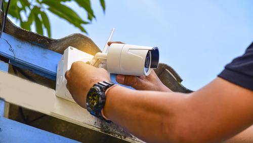 Technician installing wireless CCTV camera